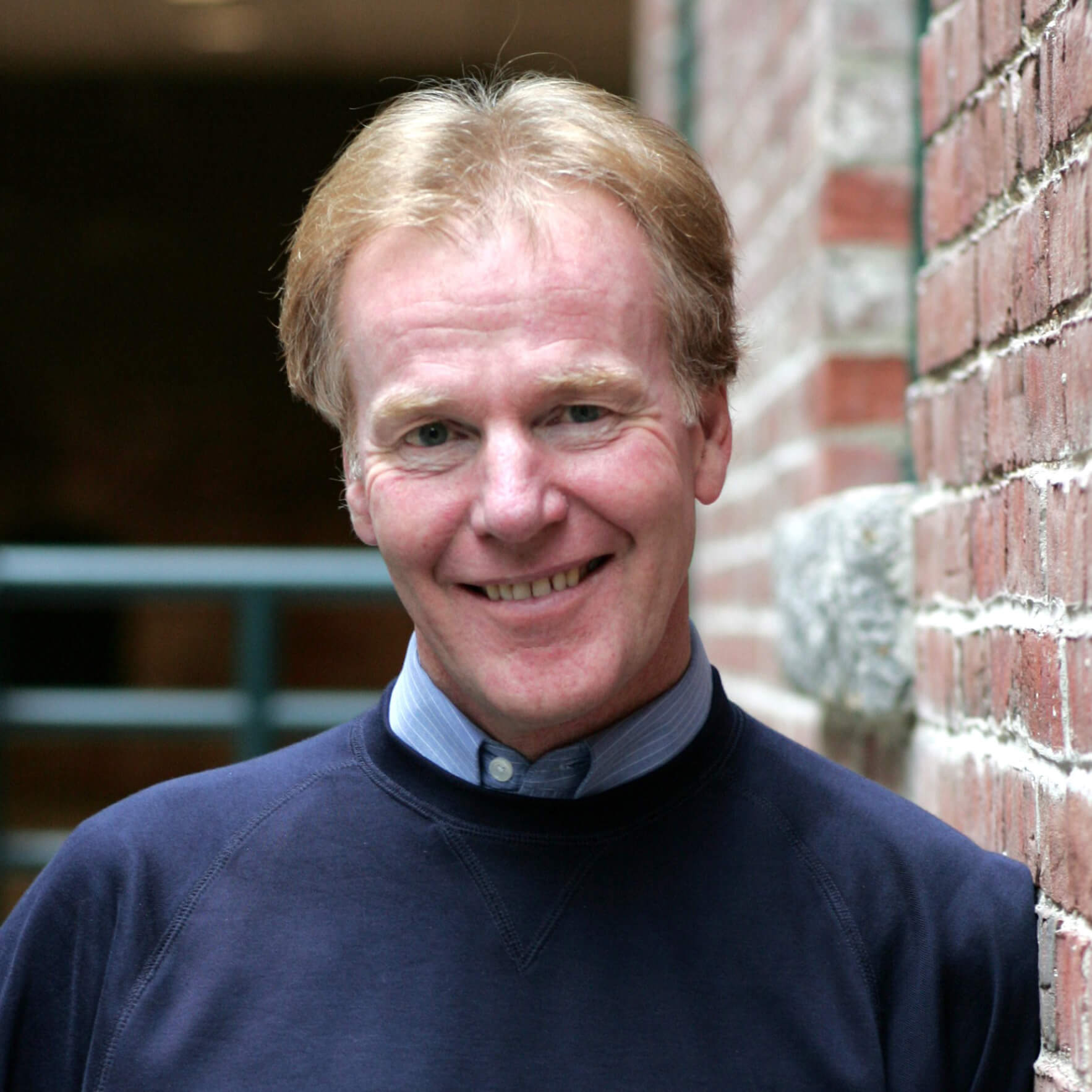Headshot of Peter Senge, author of The Fifth Discipline